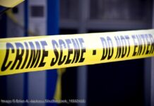 Close up crime scene investigation police boundary tape. © Brian A. Jackson/Shutterstock