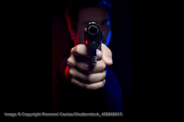 Gun Pointed at Viewer - PhoGun Pointed at Viewer - Photo: © Copyright Rommel Canlas/Shutterstockto: © Copyright Rommel Canlas/Shutterstock