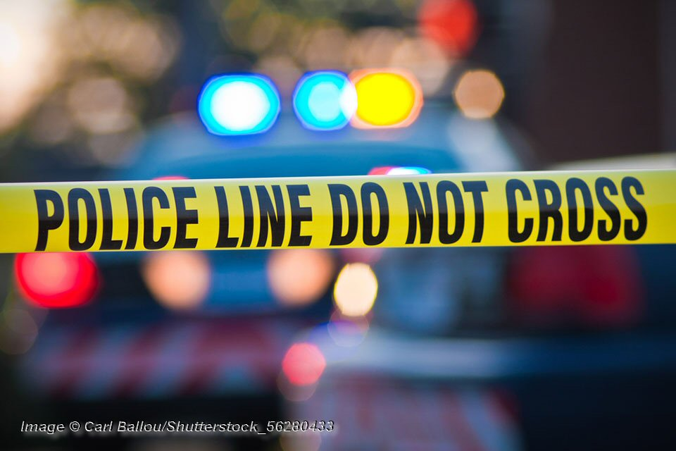 Police line do not cross. Photo © Carl Ballou/Shutterstock Shallow depth of field image taken of yellow law enforcement line with police car and lights in the background. © Carl Ballou/Shutterstock Image © Carl Ballou/Shutterstock_56280433