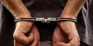 Close-up. Arrested man handcuffed - Photo: © Copyright Jinga/Shutterstock