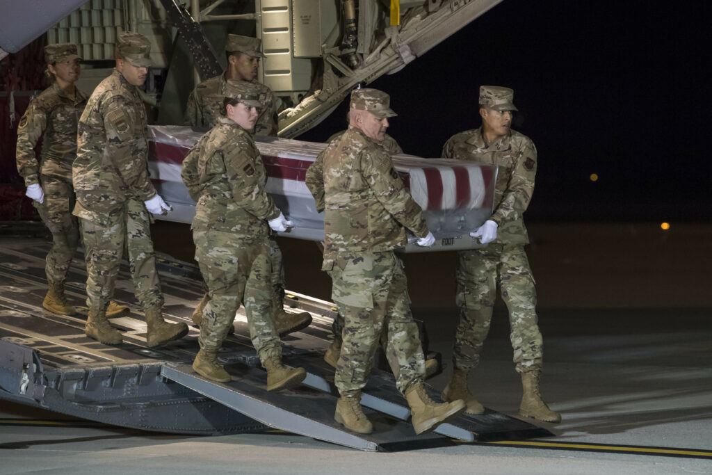 A U.S. Air Force carry team transfers the remains of Seaman Apprentice Cameron S. Walters, of Richmond Hill, Ga., at Dover Air Force Base, Del., Dec. 8, 2019. Walters was assigned to the Naval Aviation Schools Command, Naval Air Station Pensacola, Fla. (U.S. Air Force Photo by Senior Airman Christopher Quail)