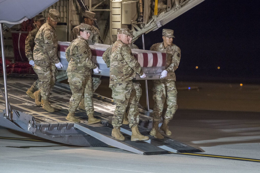 A U.S. Air Force carry team transfers the remains of Mohammed S. Haitham at Dover Air Force Base, Del., Dec. 8, 2019. Haitham was assigned to the Naval Aviation Schools Command, Naval Air Station Pensacola, Fla. (U.S. Air Force Photo by Senior Airman Christopher Quail)