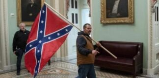 FBI photo of man with Confederate flag at US Capitol